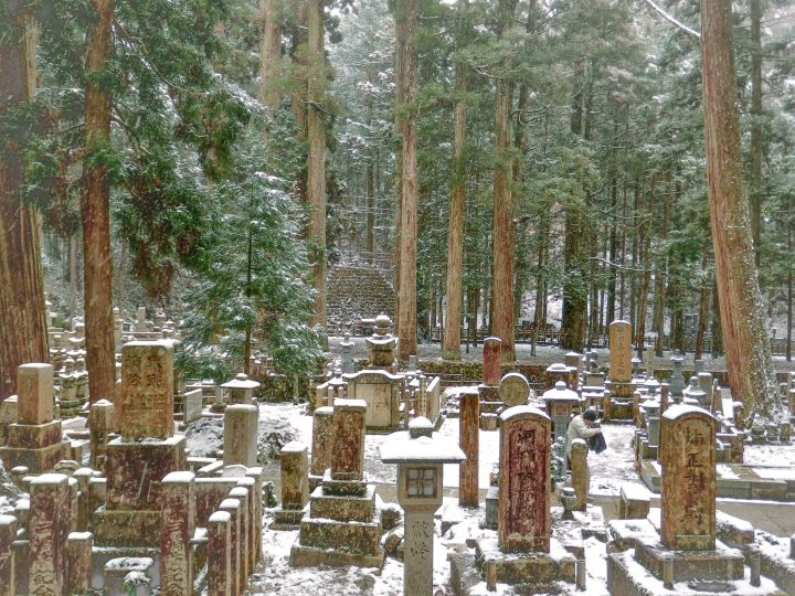 Graves covered in light snow in the forest in Okunoin Cemetery