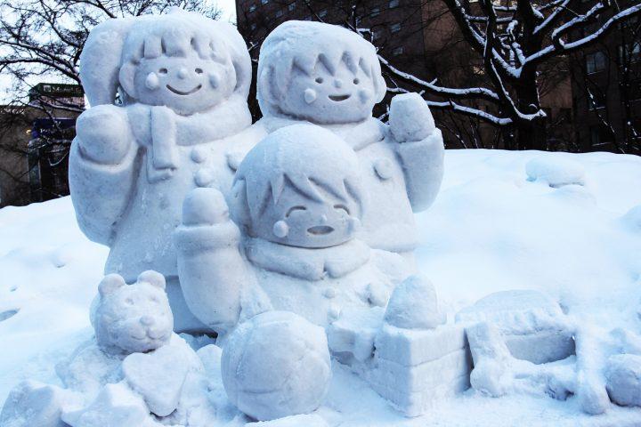 Ice sculpture of smiling children in Sapporo Snow festival