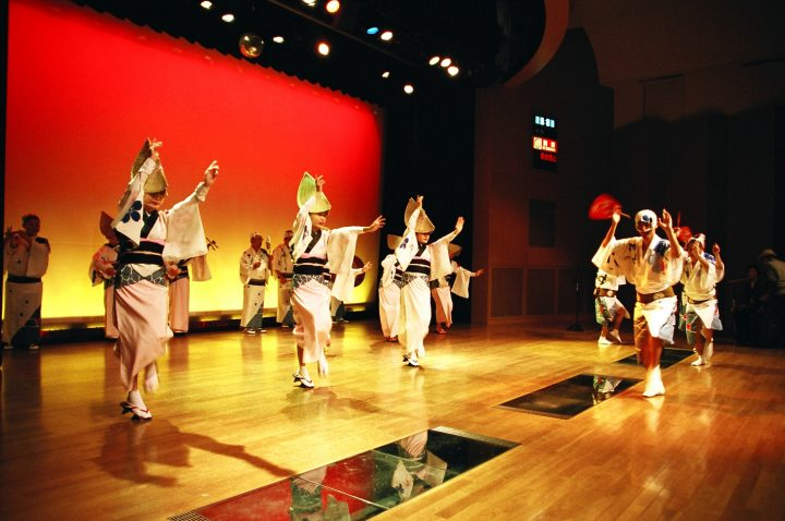 Dancers in traditional clothes on stage during show