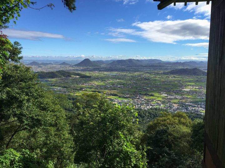 Sunny day over green populated valley in Shikoku