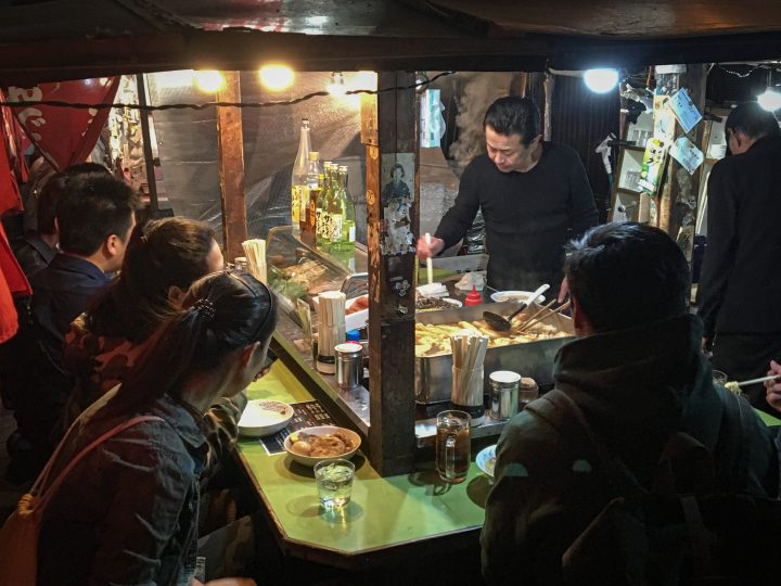 Chef preparing street food for patrons