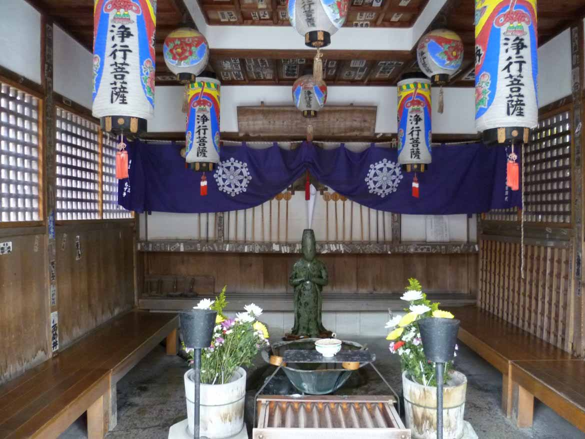 A small area for offerings just to the right of the main building.