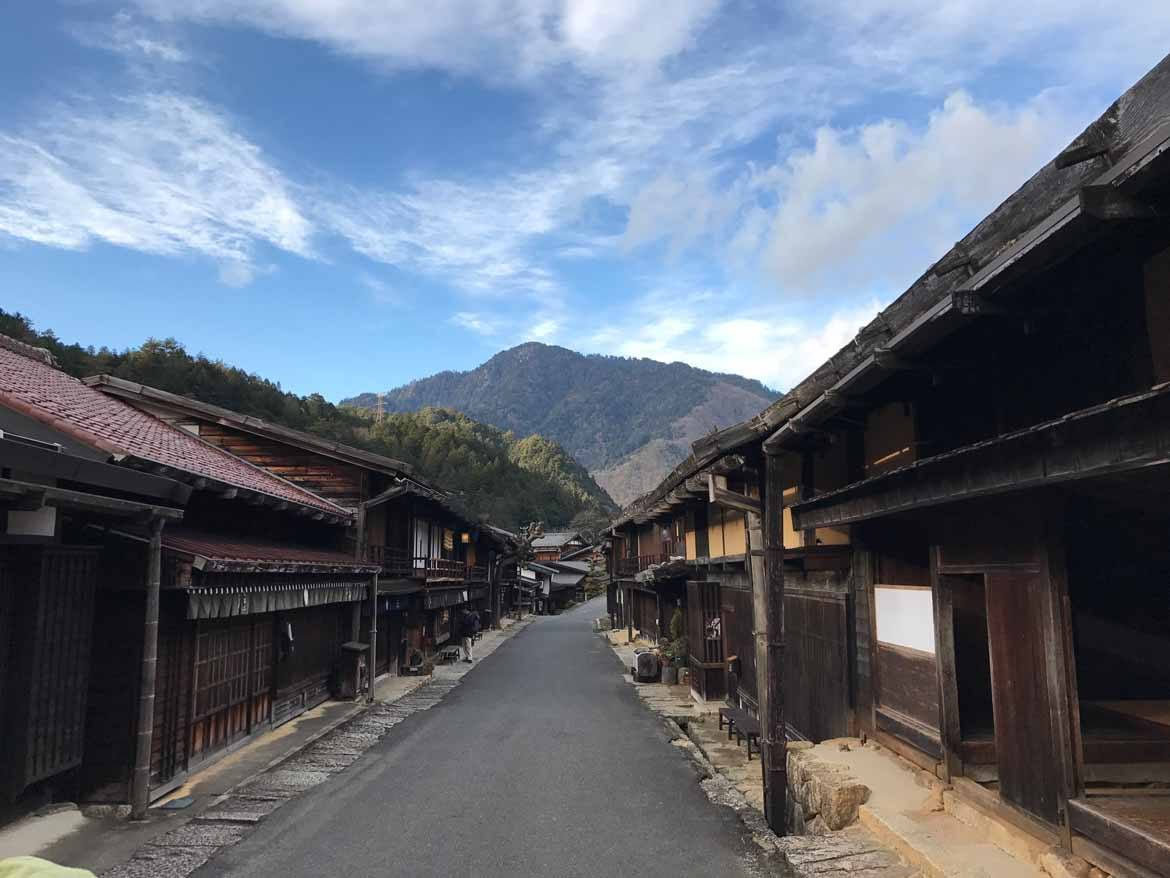 This is Tsumago, with Mount Ise in the background. Mount Ise is 1373 metres tall. Due to the efforts of the locals to preserve its history you can experience how it looked like in the Edo period here in this old post town.