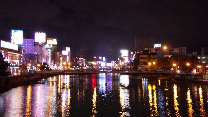 Neon lights reflected in the water at Nakatsu Fukuoka, Japan