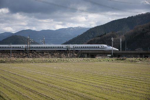 Shinkansen (bullet train) driving through fields in Japan