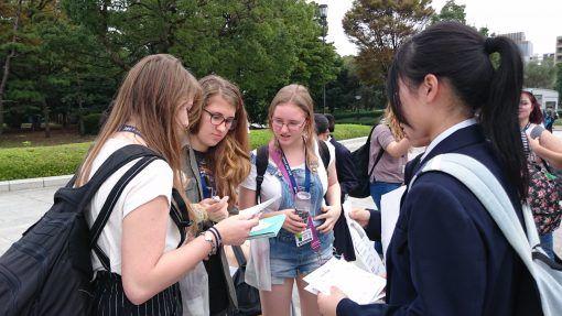 Teenagers looking at leaflets in Japan