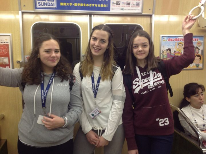 Japan train with teenagers on a school tour