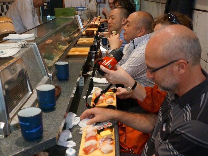 People eating at Tsukiji fish market
