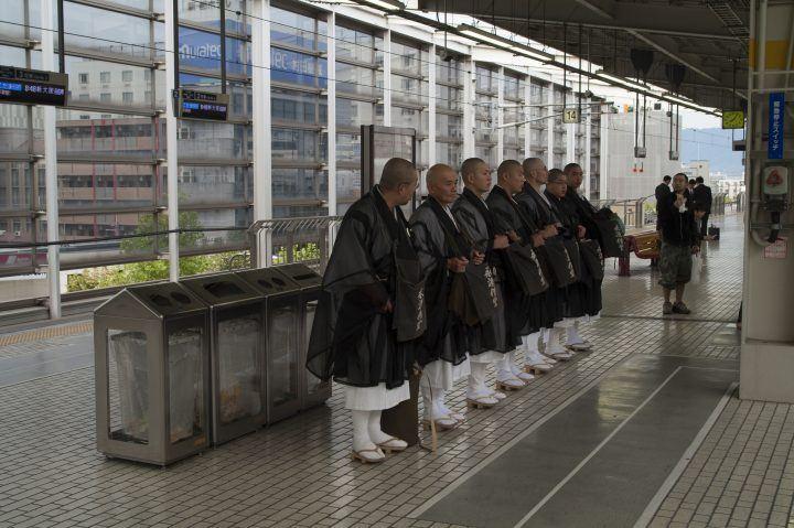 Monks queuing for the shinkansen