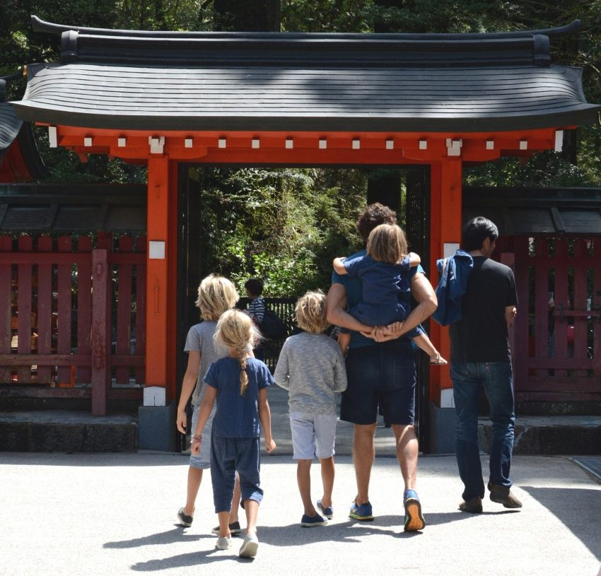 The Adamo family at a temple