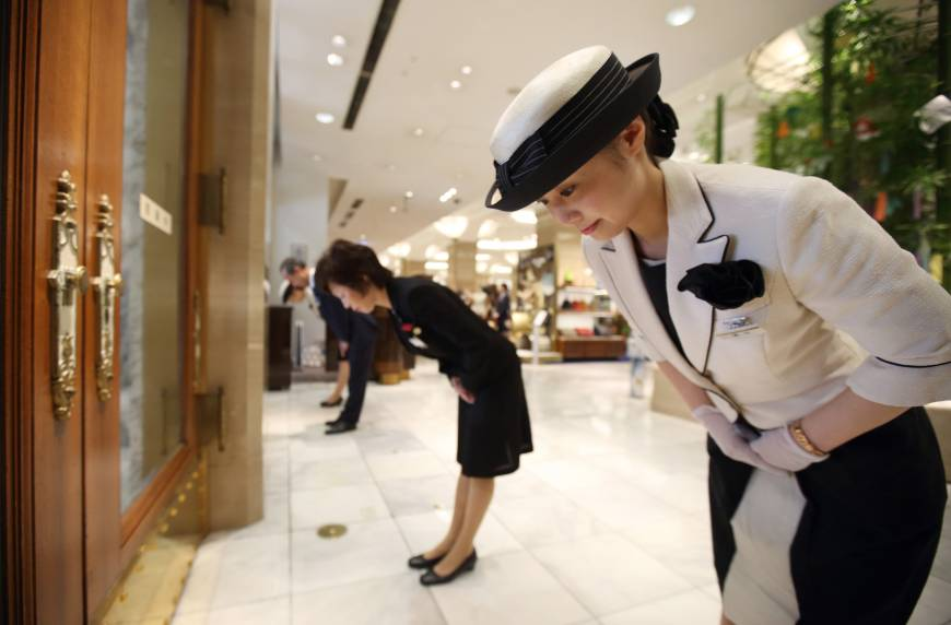 Department store staff prepare to open their doors to customers