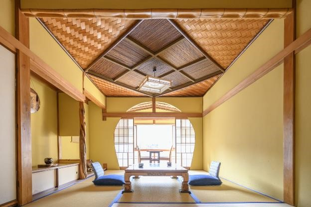 Traditional Japanese accommodation in Misasa Onsen with bright colors and circular window