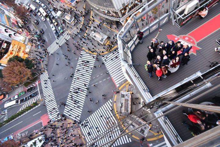 Aerial shot of people on buildings and street in Shibuya