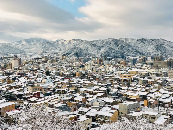 City with snowed roofs surrounded by mountains