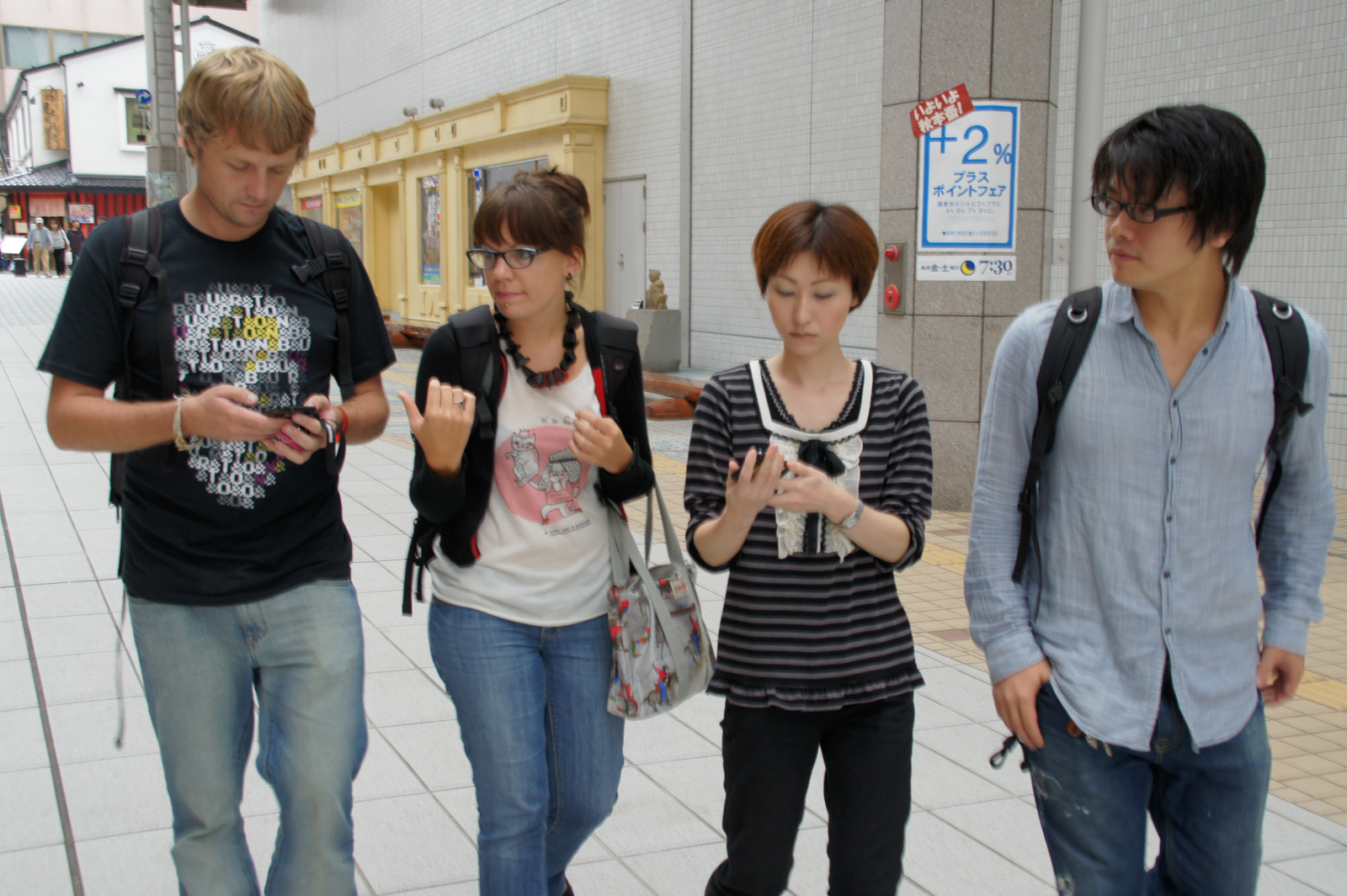 Caucasian couple walk next to Japanese couple in Japan