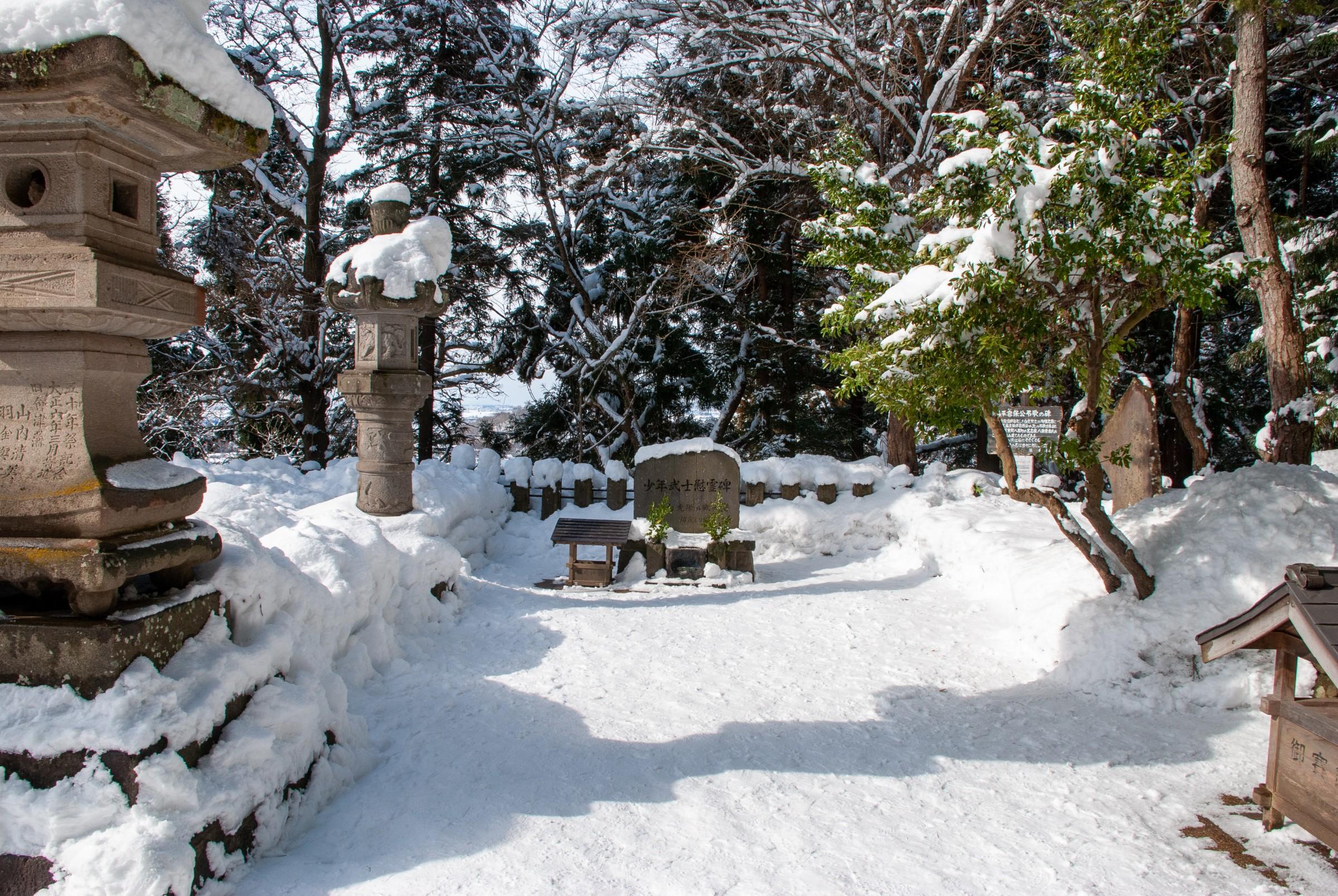 Snow-covered samurai graves at the top of Iimori hill in Aizu-Wakamatsu