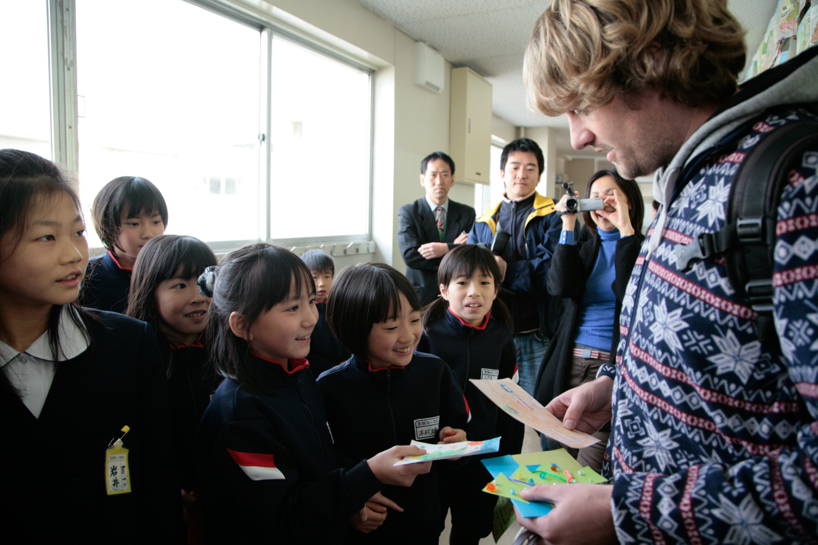 School children give gifts to volunteer helping after the 2011 earthquake