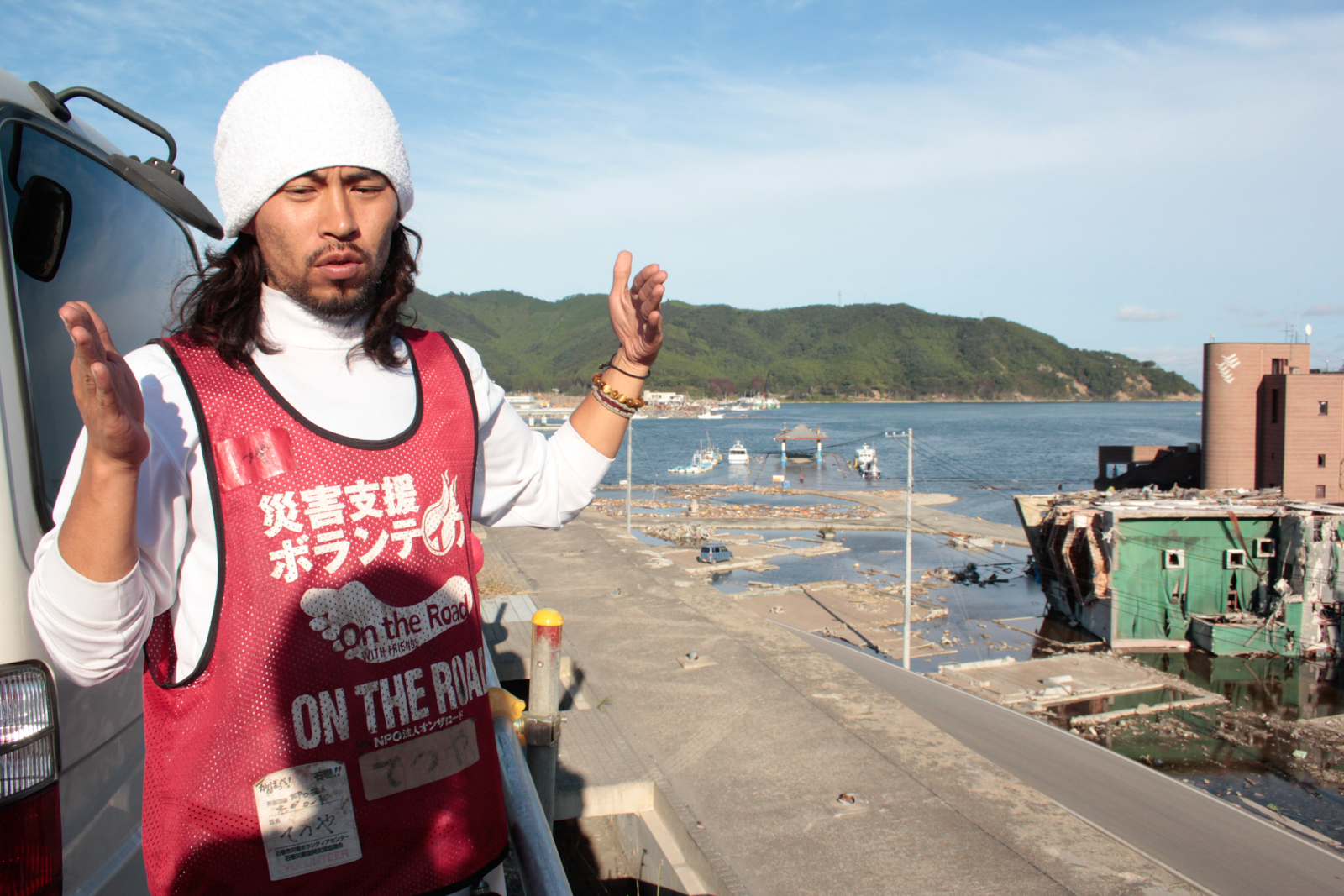 Volunteer prepares to help with the cleanup after the tsunami in Tohoku