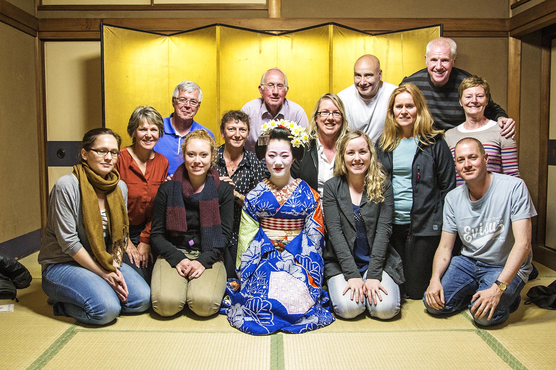 An InsideJapan tour group with a maiko